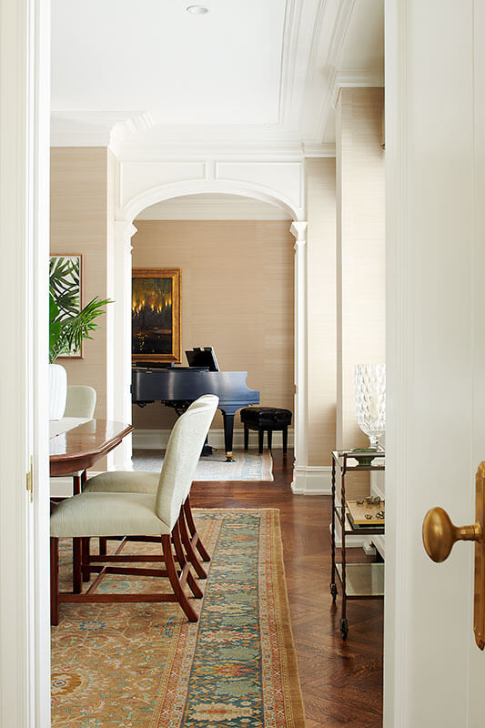 dining table and hallway of sophisticated condo by Shay Construction